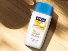 Crema de fata fluida Nivea Sun Light Feeling Face Fluid SPF 30